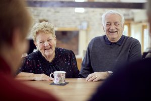 Older couple having tea