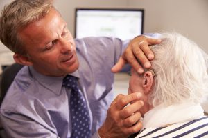hearing aid being fitted